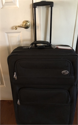 sold!  American Tourister luggage  One black rolling suitcase for sale  Cherry Hill New Jersey