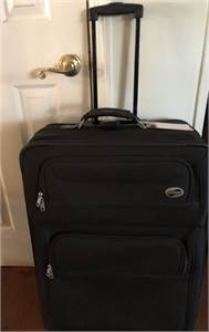 American Tourister luggage  One black rolling suitcase for sale  Cherry Hill New Jersey