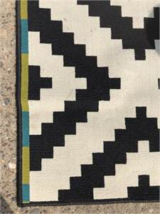 Black and white patterned rug for sale originally from Ikea